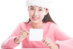 Молодая азиатская женщина при шляпа рождества изолированная на белизне Стоковая Фотография