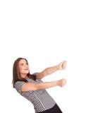 Молодая дама gesturing с космосом экземпляра Стоковые Изображения
