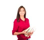 Молодая латинская девушка держа кучу книг Стоковые Фотографии RF