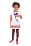 Молодая африканская азиатская девушка держа стетоскоп стоковое фото rf