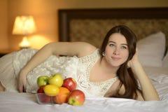Молодая беременная женщина Стоковая Фотография