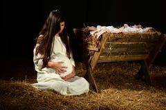 Молодая беременная Mary с кормушкой Стоковое Фото