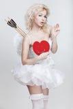 Молодая белокурая женщина в костюме ангела Стоковое фото RF