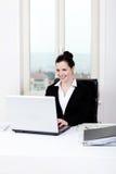 Молодая бизнес-леди в офисе Стоковое фото RF