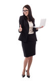 Молодая бизнес-леди при большие пальцы руки компьтер-книжки вверх изолированные на белизне Стоковые Фото