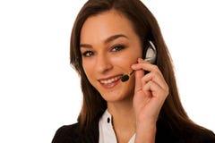 Молодая бизнес-леди при шлемофон изолированный над белой предпосылкой Стоковое фото RF