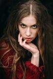 Молодая ведьма в лесе осени Стоковые Изображения