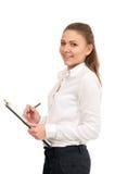 Молодая женщина в белой рубашке держит бумаги офиса изолировано Стоковое фото RF