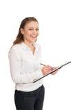 Молодая женщина в белой рубашке держит бумаги офиса Стоковое фото RF