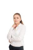 Молодая женщина в белой рубашке против белой предпосылки Стоковое фото RF