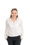 Молодая женщина в белой рубашке против белой предпосылки Стоковые Фотографии RF