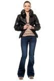Молодая женщина в голубые джинсы Стоковое Изображение