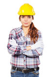 Молодая женщина в желтом шлеме конструкции Стоковое Изображение RF