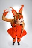 Молодая женщина в изображении красной белки Стоковая Фотография RF