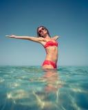 Молодая женщина в море Стоковые Фотографии RF