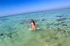 Молодая женщина в море Стоковое Фото