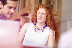 Молодая женщина в офисе Стоковая Фотография RF