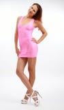 Молодая женщина в розовом платье стоковая фотография rf