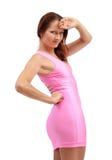 Молодая женщина в розовом платье стоковые изображения