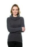 Молодая женщина в свитере стоковое фото