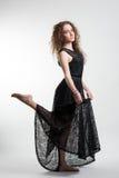 Молодая женщина в черном платье Стоковая Фотография RF