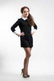Молодая женщина в черном платье Стоковая Фотография
