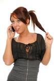Молодая женщина говоря к клетке Стоковые Фотографии RF