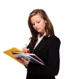 Молодая женщина держа блокнот Стоковое Фото