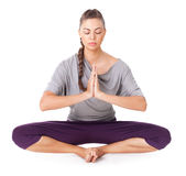 Молодая женщина делая представление угла asana йоги связанное Стоковые Изображения