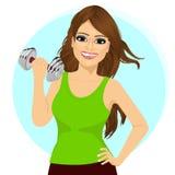 Молодая женщина делая разминку фитнеса с гантелью Стоковое фото RF