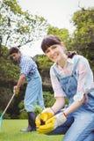 Молодая женщина засаживая деревце Стоковое Изображение