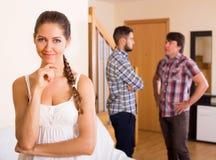 Молодая женщина имея ссору с людьми Стоковые Изображения RF