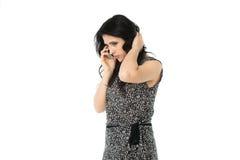 Молодая женщина используя телефон Стоковые Фотографии RF
