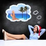Молодая женщина мечтая о праздниках Стоковые Фото