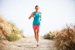 Молодая женщина на ее jog вечера Стоковое фото RF