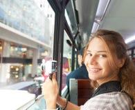Молодая женщина на камере от окна туристического автобуса Стоковые Фотографии RF