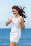 Молодая женщина на море стоковое фото