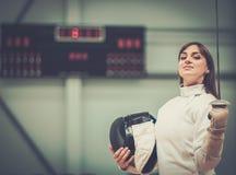 Молодая женщина на ограждая тренировке Стоковое фото RF