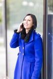 Молодая женщина на телефоне Стоковая Фотография RF