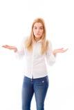 Молодая женщина не знает чего сделать изолировала на белой предпосылке стоковое фото