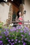 Молодая женщина около двери Стоковая Фотография RF