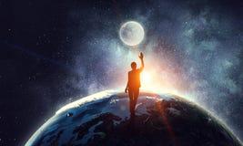 Молодая женщина достигая луну Стоковая Фотография RF