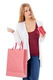 Молодая женщина показывает ее пустой бумажник банкротство Стоковое Изображение RF