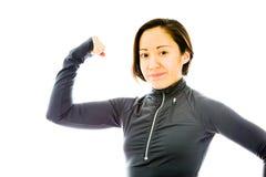 Молодая женщина показывая ее мышцу Стоковое фото RF