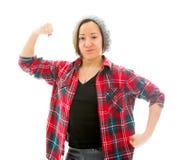 Молодая женщина показывая ее мышцу Стоковые Фото