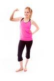 Молодая женщина показывая ее мышцу Стоковые Фотографии RF