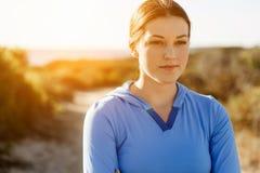 Молодая женщина после спорта стоковое фото