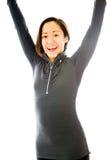 Молодая женщина празднуя при ее поднятые оружия Стоковые Фотографии RF