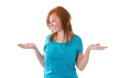 Молодая женщина принимает решениее стоковое изображение