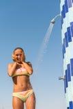 Молодая женщина принимая ливень Стоковые Фотографии RF